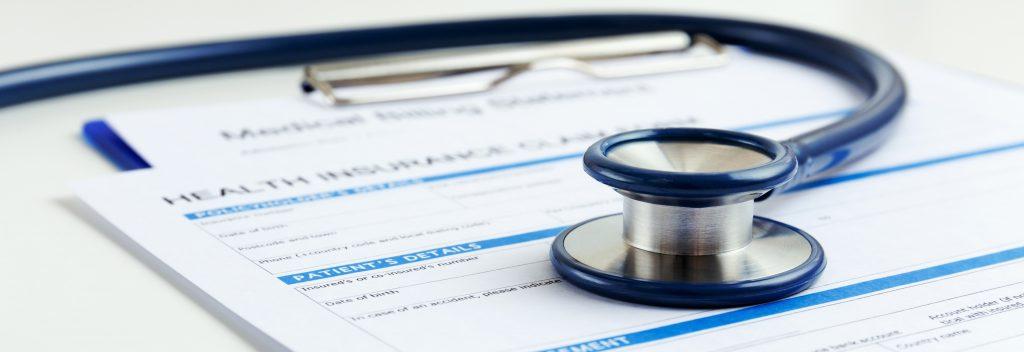stethoscope on paperwork