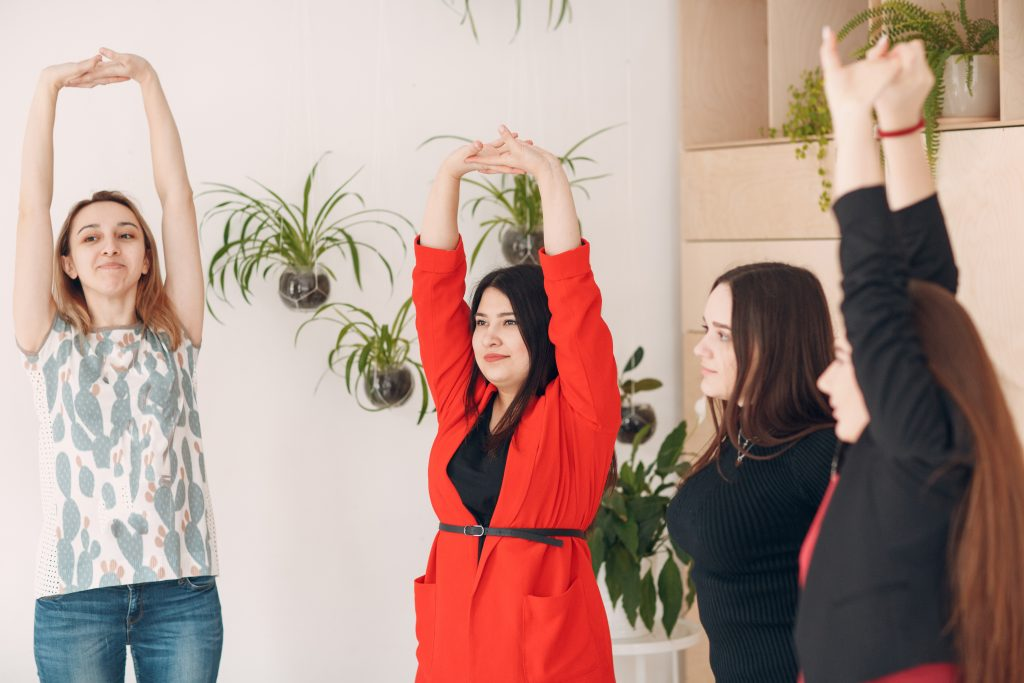 Women exercising in the office